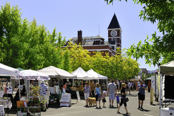 People shopping at the downtown market near City Hall in Duncan, BC.