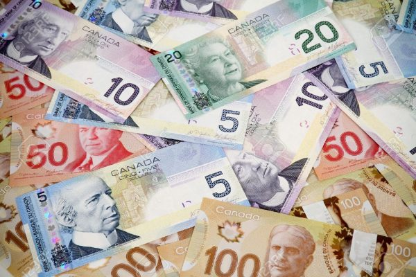 16615862-Big-pile-of-money-Canadian-dollars-Stock-Photo-canada